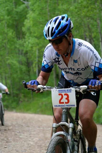 Team Bikeparts.com racer, Jason Kompf, climbing the first of many hills in the Gold Rush Run